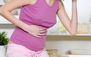 Почему болит желудок при беременности?